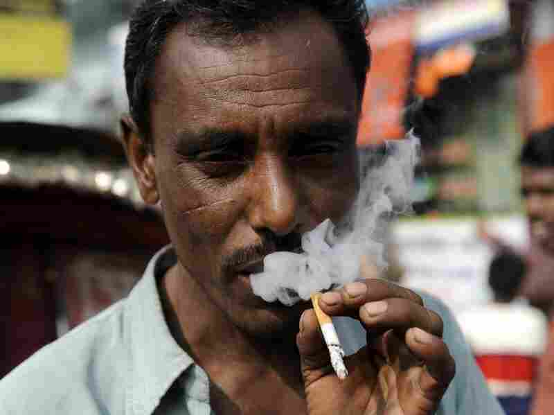 A man exhales smoke in Dhaka, Bangladesh. The latest World Health Organization-Bangladesh government survey has found 43.3 per cent of the country's adult population now use tobacco, up from 37 percent in 2004.