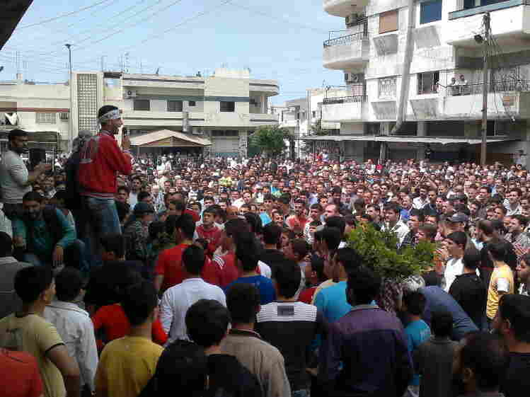 """Syrian anti-government protesters demonstrate in Banias on April 29, the """"Day of Rage"""" called by activists to pile pressure on President Bashar Assad as his regime enacted a violent crackdown on dissent."""
