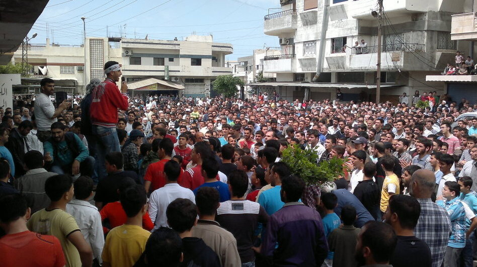 "Syrian anti-government protesters demonstrate in Banias on April 29, the ""Day of Rage"" called by activists to pile pressure on President Bashar Assad as his regime enacted a violent crackdown on dissent."