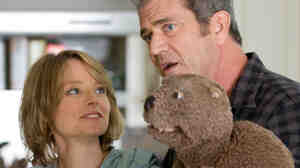 Gnawing problems: Mel Gibson (right, with Jodie Foster) plays a man who deals with crushing depression from behind the psychological shield of a hand puppet.