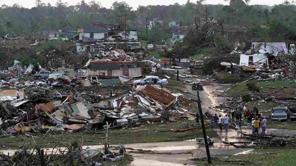 Residents survey the destruction after a tornado hit Pratt City, Ala., on April 27. Short-term forecasting of twisters like the ones that swept the South this week has grown increasingly accurate, but long-term forecasting remains highly unreliable.