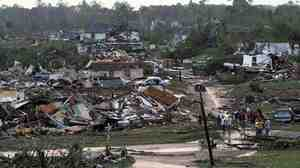 Residents survey the destruction after a tornado hit Pratt City, Ala., on April 27. Short-term foreca
