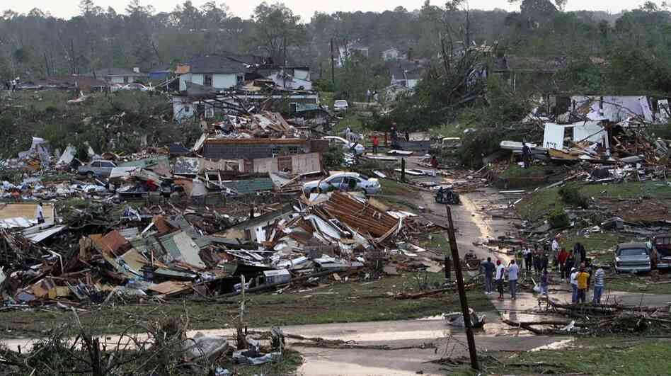 Residents survey the destruction after a tornado hit Pratt City, Ala., on April 27. Short-term forecasting of twisters like the ones