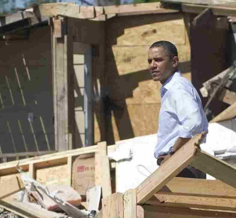 President Barack Obama toured tornado damage in Tuscaloosa, Ala. Obama walked through piles of splintered debris.