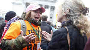 A Tea Party supporter, left, argues with a critic before a rally where former Alaska Gov. Sarah Palin spoke at the Wisconsin State Capitol in Madison on April 16.