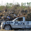 A damaged truck in a tornado-ravaged area near Rainsville, Ala.