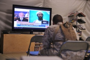 A U.S. Marine watches the news of bin Laden's death at Camp Dwyer in Helmand province, Afghanistan.