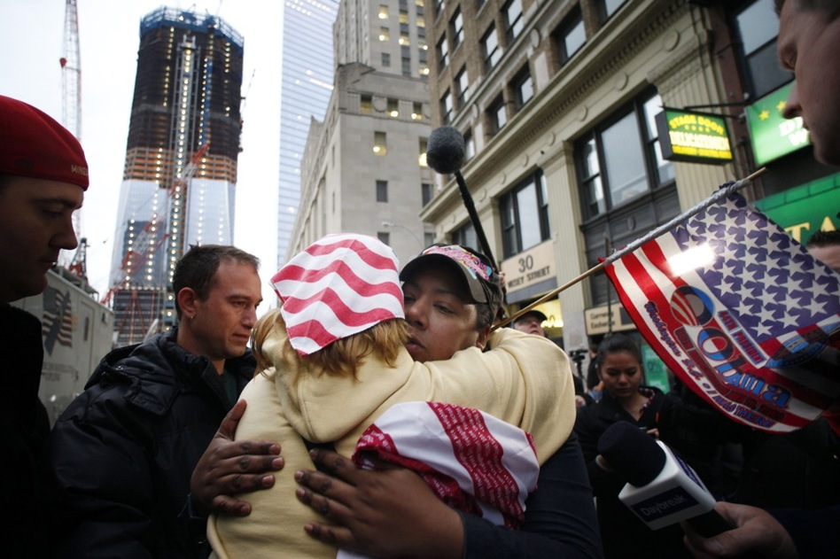 Dionne Layne, facing camera, hugs Mary Power at ground zero in New York on Monday as they react to the news.  (AP)