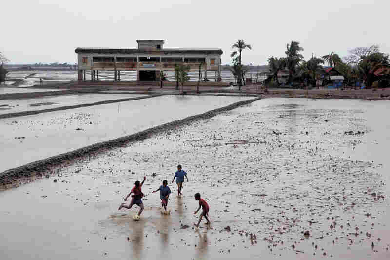 Children play on in Jaliakhali, a village devastated by Cyclone Aila in 2009. That storm sent residents racing for one of thousands of recently built cyclone shelters (above), many of which double as community centers.