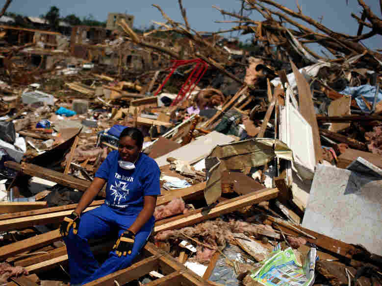 In Tuscaloosa, Ala., on Saturday, LaTia Cobbs sat in the rubble of her destroyed home.