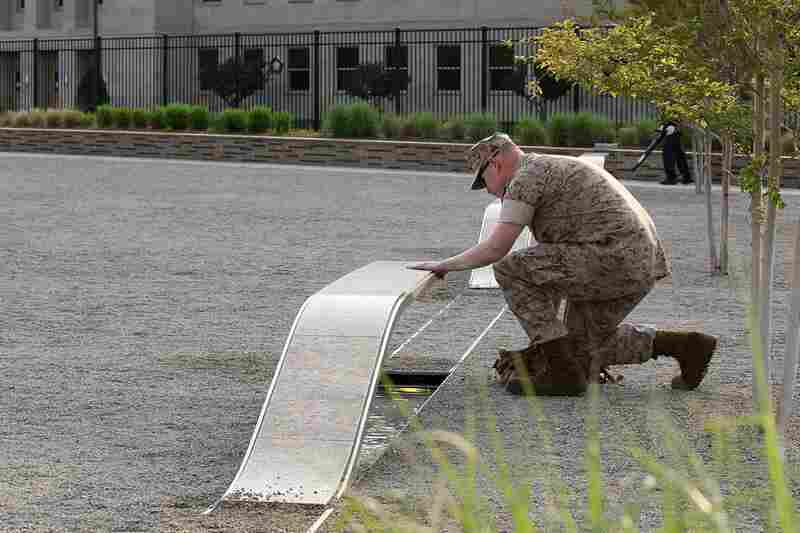 U.S. Marine Staff Sgt. Mark Gamache pays respects to victims of the Sept. 11 terrorists attacks, at the Pentagon Memorial in Arlington, Va.
