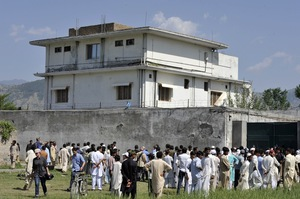 Pakistani media and local residents gather outside the compound. Revelations that bin Laden had been hiding here, possibly for years, have embarrassed Pakistan's military and intelligence establishment.