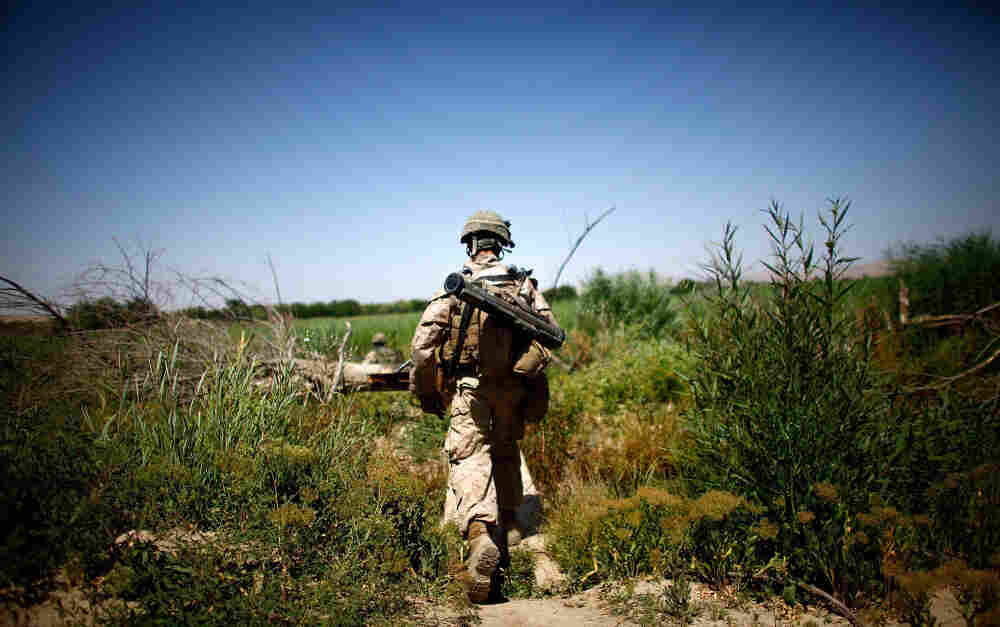 A Bravo Company Marine from Camp Pendleton, Calif., patrols in the Helmand River  Valley in southern Afghanistan on Monday.