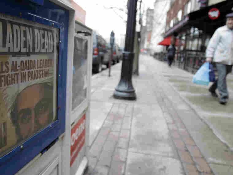 A man walks past a Plain Dealer newspaper box in Cleveland on Monday, the day after President Obama announced that a U.S military mission had ended the life of Osama bin Laden.