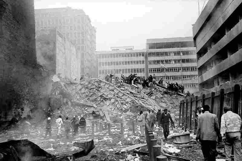 Simultaneous car bomb explosions linked to local al-Qaida cells destroyed the U.S. embassies in Nairobi and Dar es Salaam, Tanzania, on Aug. 7, 1998. The attacks, killing more than 300 and injuring more than 4,000, mark the beginning of international attention on Osama bin Laden.