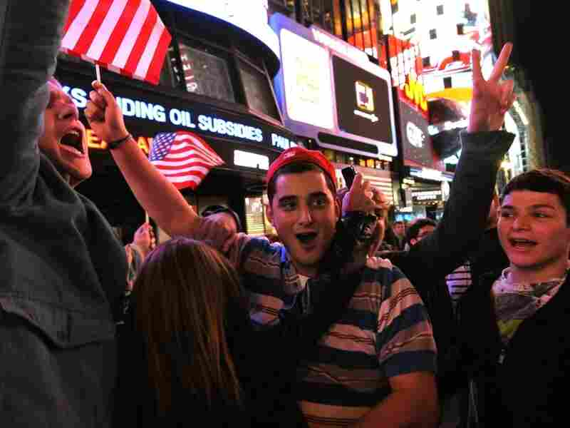 People gather in Times Square shortly after the announcement from the President Obama that Osama bin Laden was dead. Celebrations have also broken out at ground zero, and in Washington.