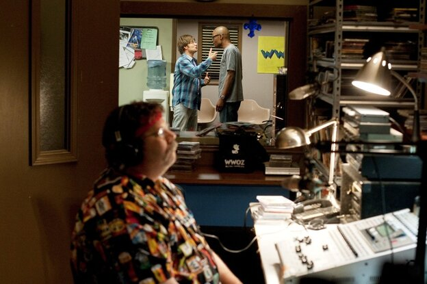DJ Davis (Steve Zahn) and his WWOZ boss (Darien Sills-Evans) argue, while DJ Jeffy Jeff (Spud McConnell) hosts programming.