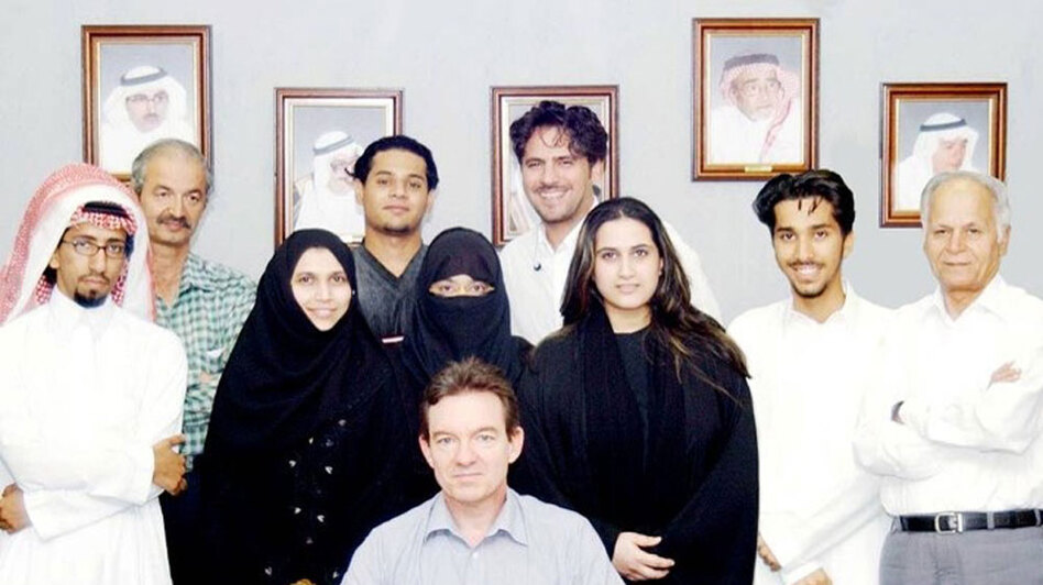 Journalist Lawrence Wright sits with several of the people he interviewed for The Looming Tower, his history of al-Qaida. (Courtesy Lawrence Wright)