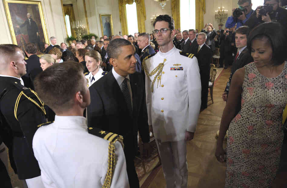President Obama and First Lady Michelle Obama leave the White House East Room after a Congressional Medal of Honor ceremony, May 2, 2011.