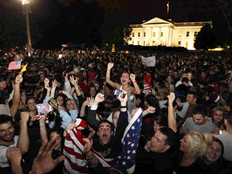 Crowds gathers outside the White House early Monday, May 2, 2011, to celebrate President Obama's announcement that U.S. troops killed Osama bin Laden.