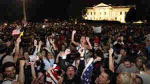 A crowd gathers outside the White House early Monday to celebrate President Obama's announcement that U.S. forces killed Osama bin Laden.