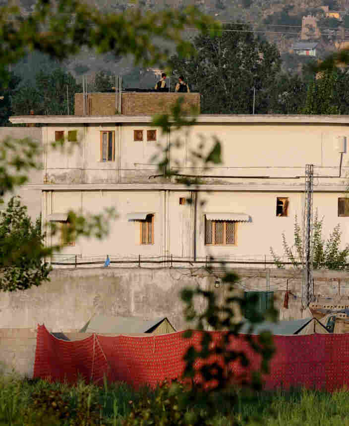 Pakistani soldiers stand guard on top of a building at the hideout of Al-Qaida leader Osama bin Laden after his death in a ground operation in Abbottabad.