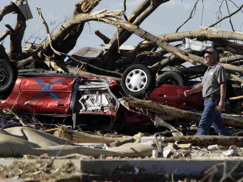 James Nicholas surveys the damage in Hackleburg, Ala., on Friday.
