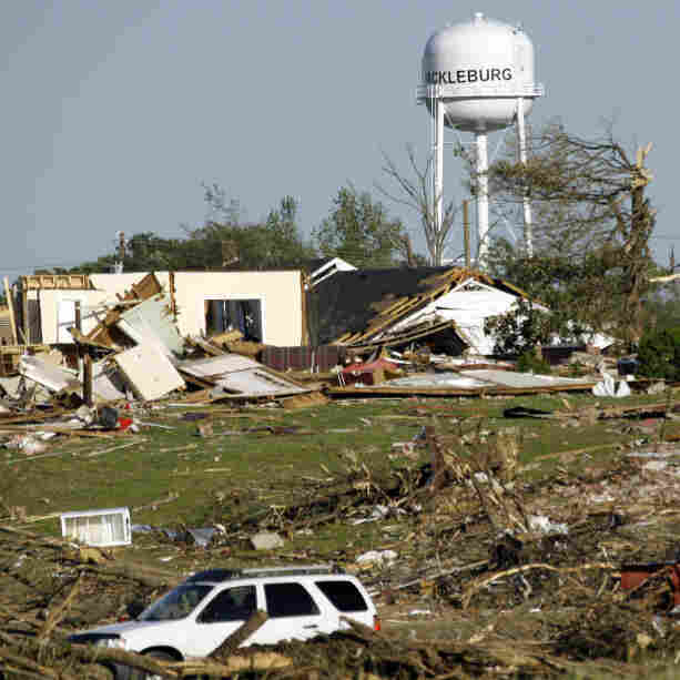 A water tower stands amid the damage in Hackleburg, Ala., on Friday, after a tornado earlier in the week destroyed much of the small community and caused nearly three dozen deaths.