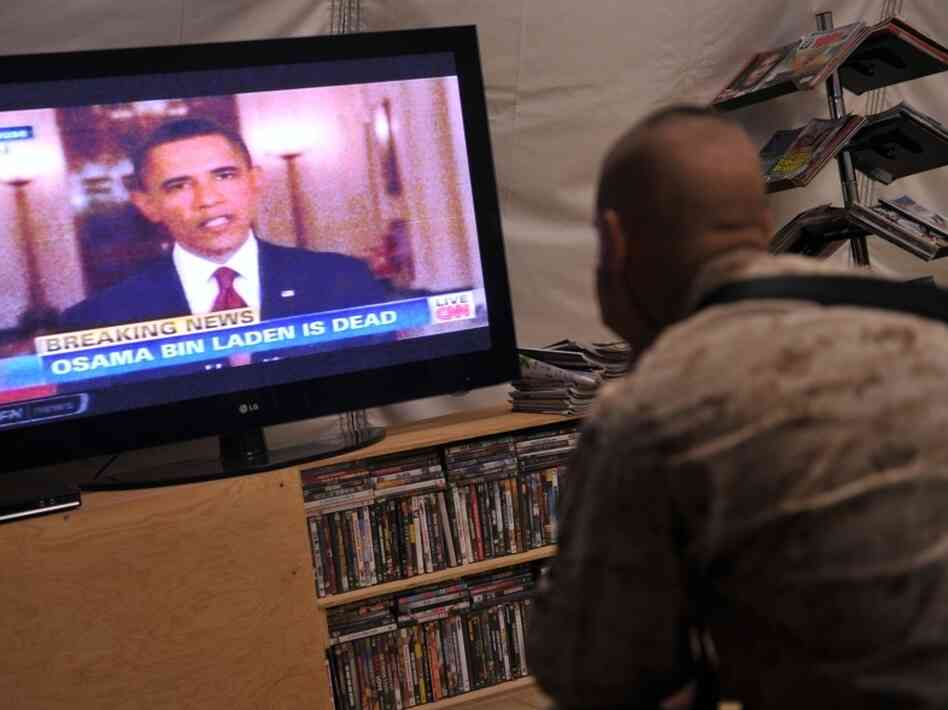 U.S. Marines of Regiment Combat Team 1 watch TV as President Barack Obama announces the death of Osama Bin Laden, at Camp Dwyer in Helman Province. President Obama said that justice had been done after the September 11, 2001 attacks.