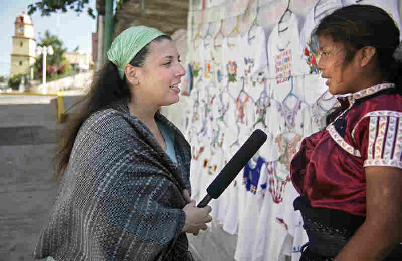 Foreign Correspondent Lourdes Garcia-Navaro interviews a local resident of Catemaco, Mexico, for a story about brujos (witch doctors) in 2007 (photo by Jake Price).