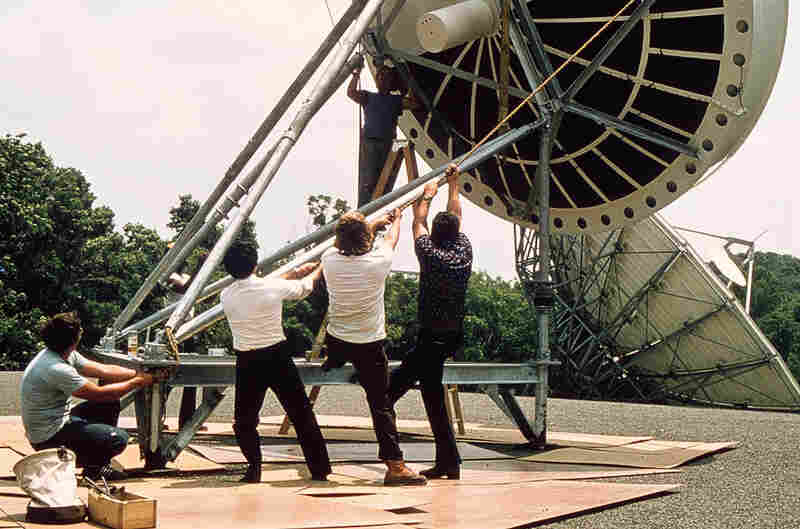 Engineers install the first satellite transmission antenna in 1979, at the MOT (Main Origination Terminal), a facility we shared with PBS in Springfield, VA (photo by George Geesey).