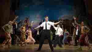 Andrew Rannells performs with an ensemble cast in The Book of Mormon, which is nominated for 14 Tony Awards.