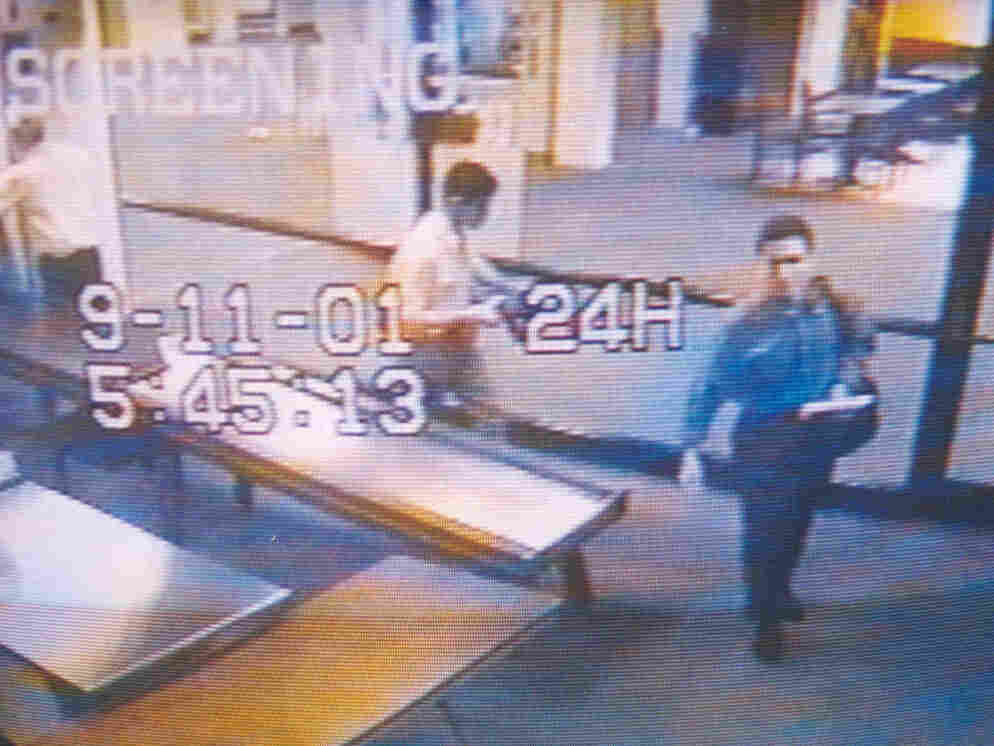Sept. 11, 2001: A surveillance camera image of two men identified by authorities as Mohammed Atta (R) and Abdulaziz Alomari (C) at the Portland International Jetport.