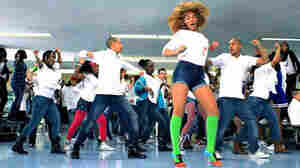 "A still from the ""Move Your Body"" video."