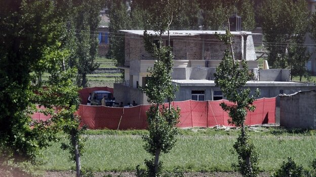 Pakistan army soldiers are seen near the house in Abbottabad where bin Laden was killed. More Photos.