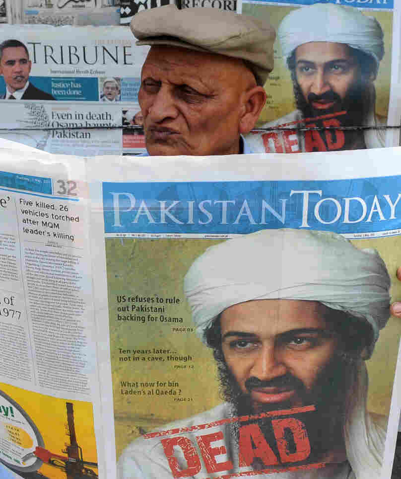 A Pakistani man reads a newspaper with the front page displaying news of the death of Osama bin Laden at a stall in Lahore on May 3, 2011.