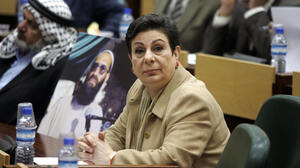 Hanan Ashrawi, a member of the Palestinian Legislative Council, says that uniting Palestinians is the only way to bring stability to the region and push forward the peace process. Here, she listens during a session of the Palestinian Parliament on March 27, 2006.