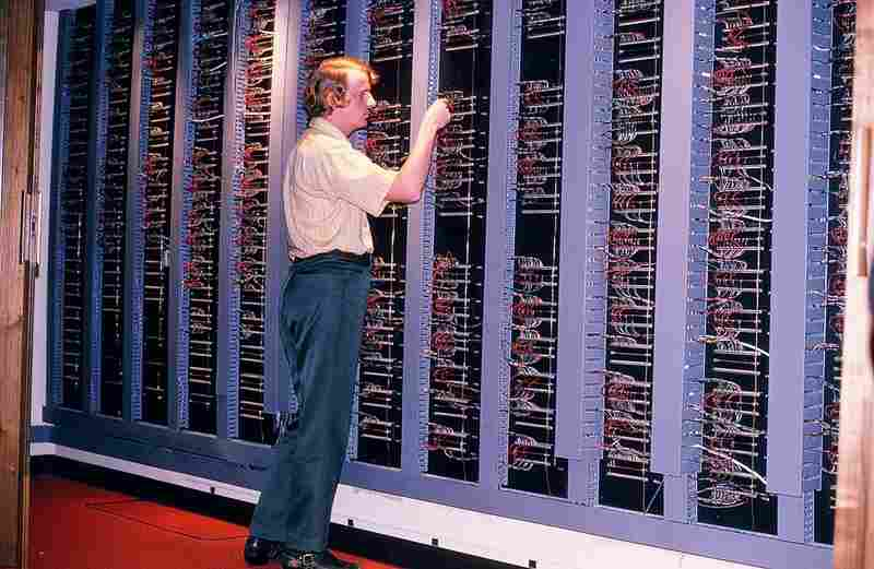 Senior engineer John Long at the Master Control wiring wall, which has 15,000 connections.