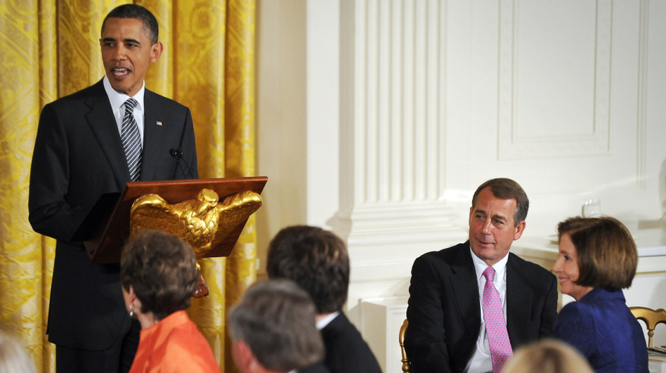 President Obama speaks as House Speaker John Boehner (second from right) and Rep. Nancy Pelosi look on during a dinner of bipartisan committee chairmen and ranking members and their spouses in the East Room of the White House on Monday.