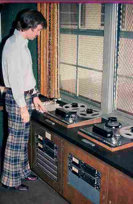 This staffer at an NPR Member station shows off the style of the 1970s and some reel-to-reel tape machines.
