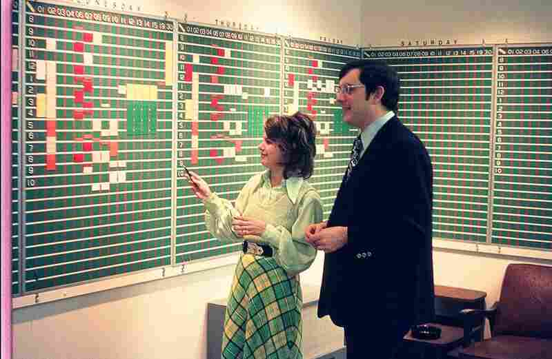 In 1973, Jane Holmes and Pete Loewenstein schedule program feeds for the land-line based transmission system (photo by Geroge Geesey).