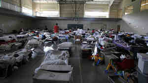 Residents who were left homeless after last week's tornado find shelter at the Belk Activity Center on Monday in Tuscaloosa, Ala.