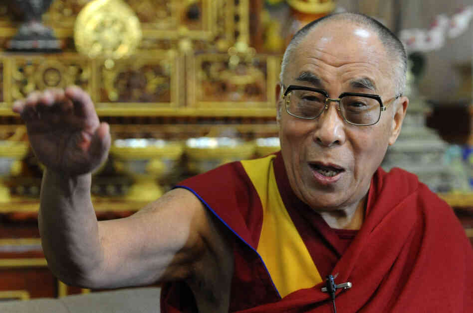 Tibetan Spiritual leader The Dalai Lama gestures as he talks to journalists in Dharamshala on March 17, 2011.