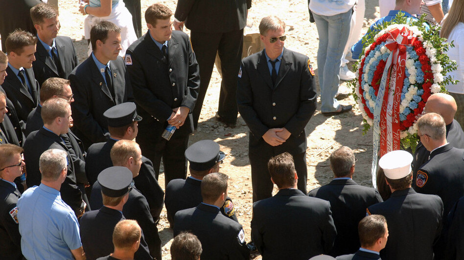 In an earlier wreathlaying, New York City firefighters mark the fourth anniversary of the Sept. 11 attacks. Thursday, President Obama will place a tribute at the site.