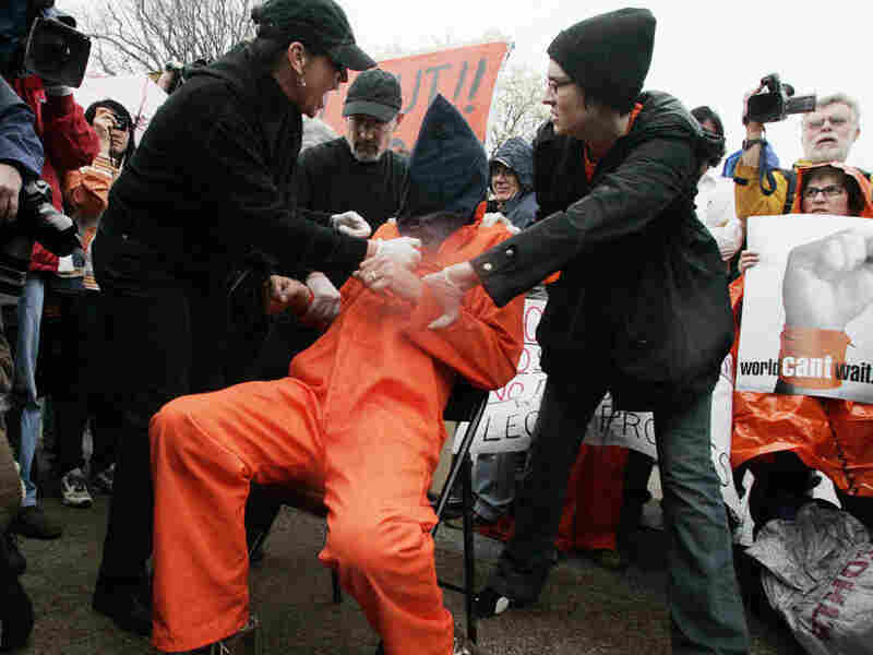 Anti-Iraq war protesters act out waterboarding, also known as simulated drowning, in 2008 in front of the White House in a series of protests that marked the fifth anniversary of the war.
