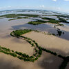 The Mississippi River floods north of New Madrid, Mo.