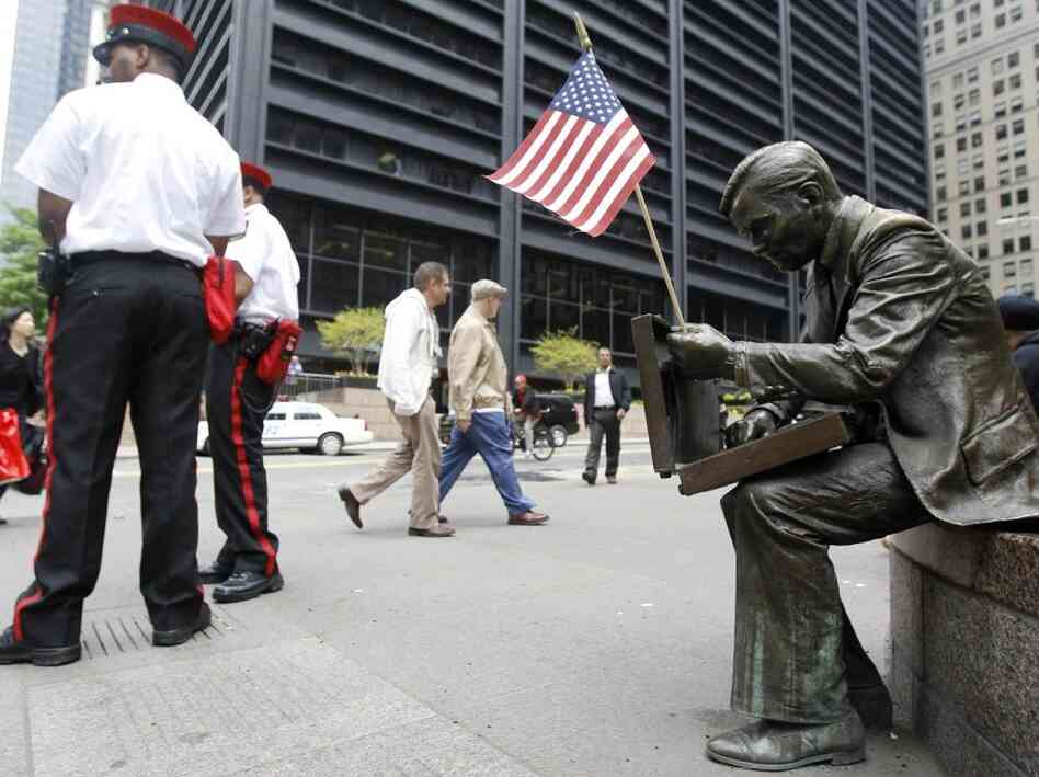 An American flag was placed on a statue near Ground Zero memorializing 9-11, May 3, 2011.