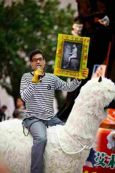 Kacey Wong, who helped organize a march in Hong  Kong in support of Ai Weiwei, took along a homemade 6-foot-tall Grass  Mud Horse, a mythical animal that Chinese netizens use as a way of  indirectly criticizing government censorship. In his hand, he holds a picture of Ai Weiwei riding his own Grass Mud Horse.
