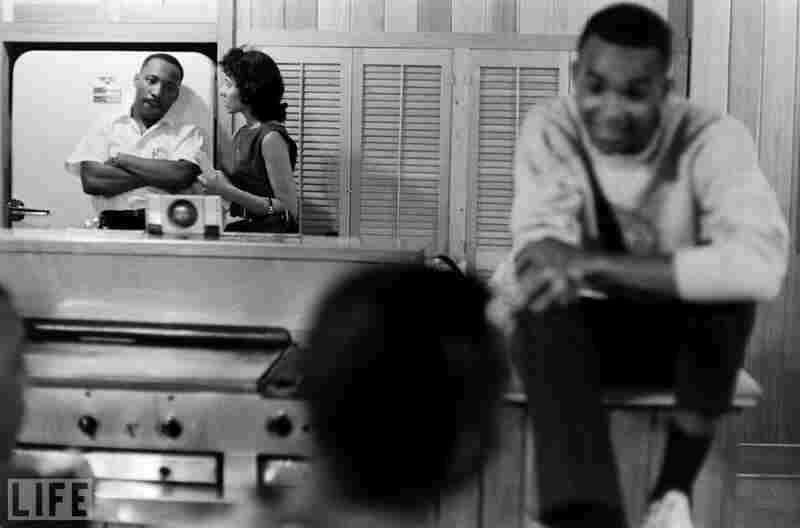 "In 1961, volunteers fill the Montgomery, Ala., home of King (left rear). In the foreground are college kids who, moved by King's message of racial equality, risked their lives as ""Freedom Riders."""