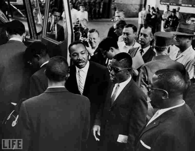 Martin Luther King Jr. (center) sees off a new group of Freedom Riders as they board a bus for Jackson, Miss., on May 24, 1961.